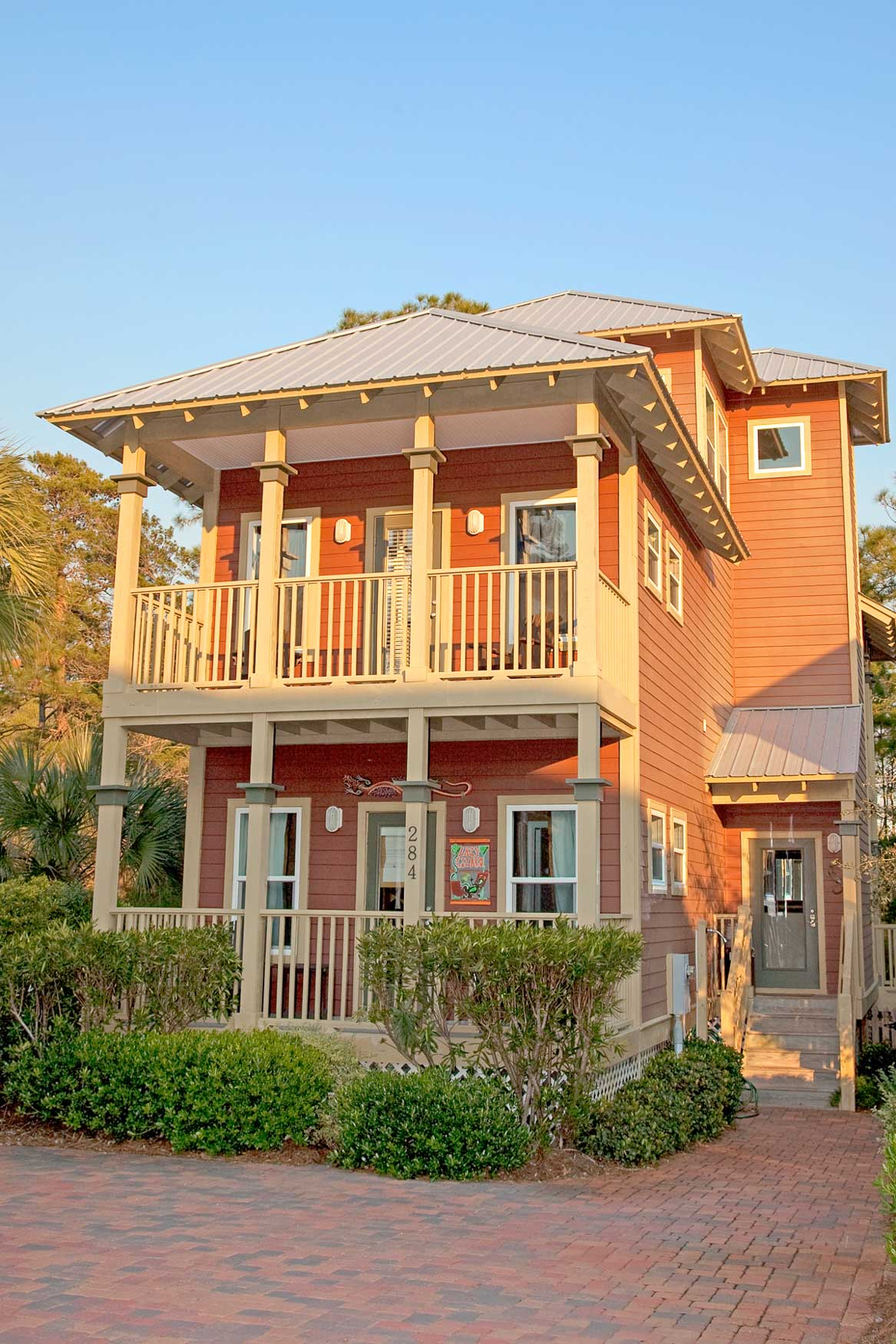Exterior of nice two storie, burnt orange New Construction home in Old Florida Village on 30A.