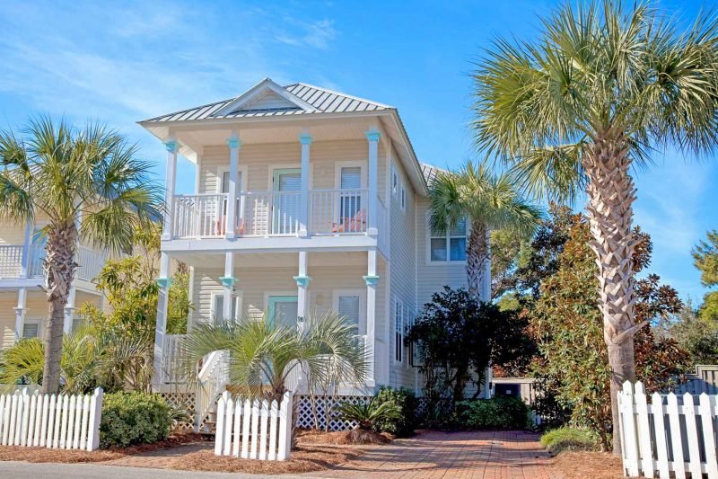 Exterior of nice two storie, light yellow color, New Construction home in Old Florida Village on 30A.