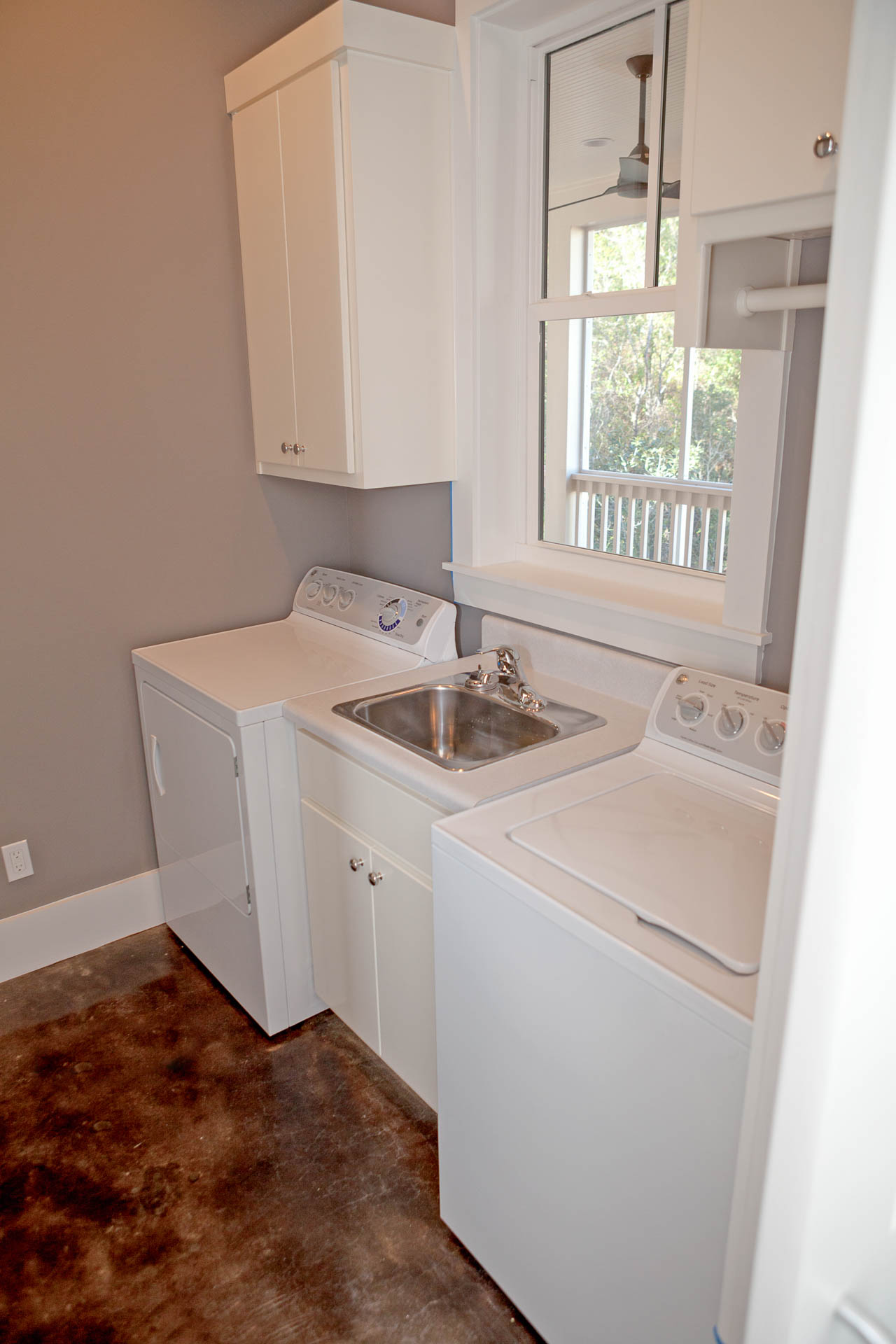 Laundry room with sink at new construction in Forest Lakes.