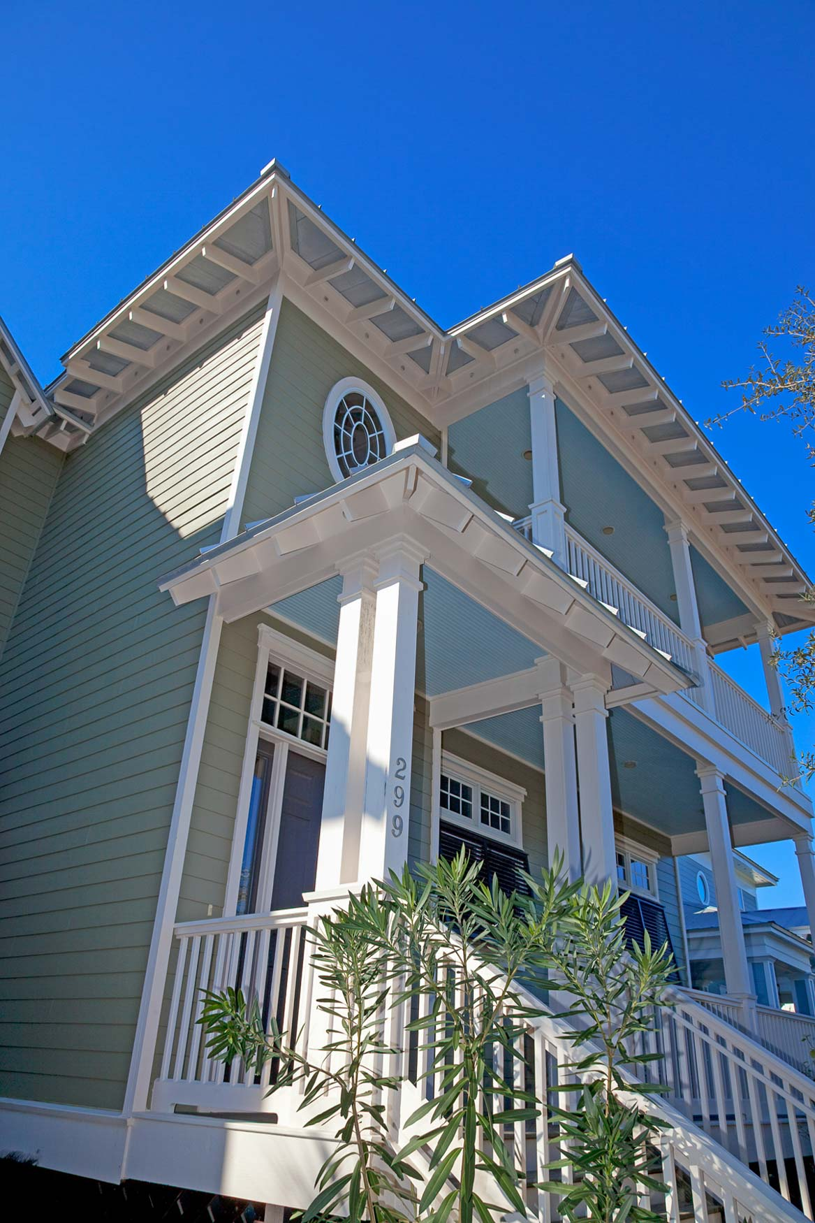 Front balcony and entry of Old Florida Beach new construction home.