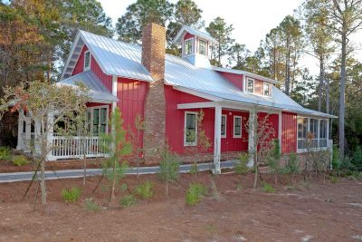 Exterior of red New constrcution home in Forest Lakes on 30A.